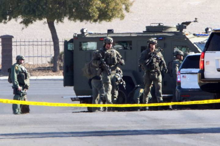 SWAT officers near Rainbow Boulevard and Darby after an officer-involved shooting in the 6900 b ...