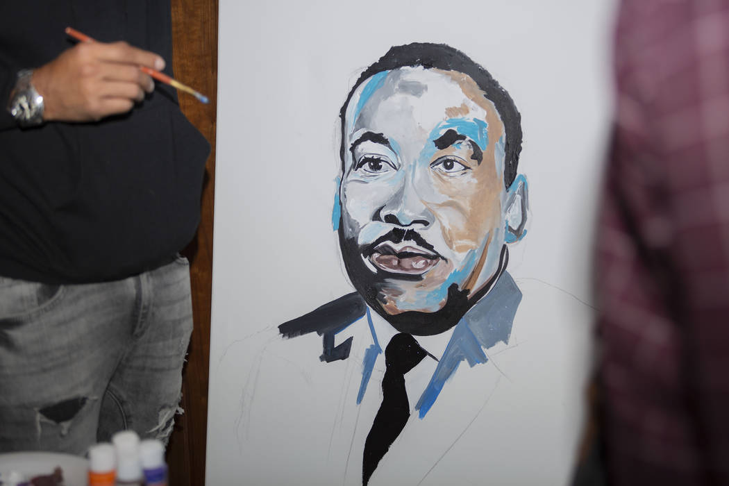 """Courtney """"Yards"""" Haywood paints a portrait of Martin Luther King Jr. at Jardin Cannabis Dispens ..."""