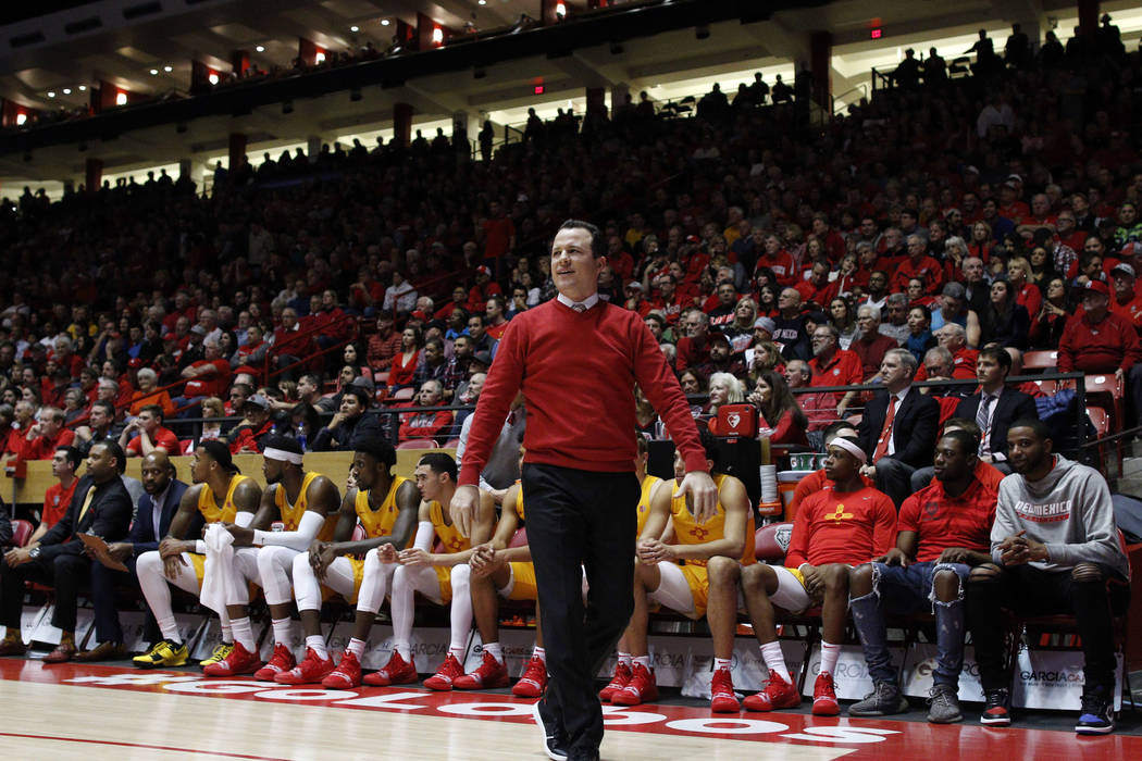 New Mexico head coach Paul Weir walks the sidelines during the first half of an NCAA college ba ...