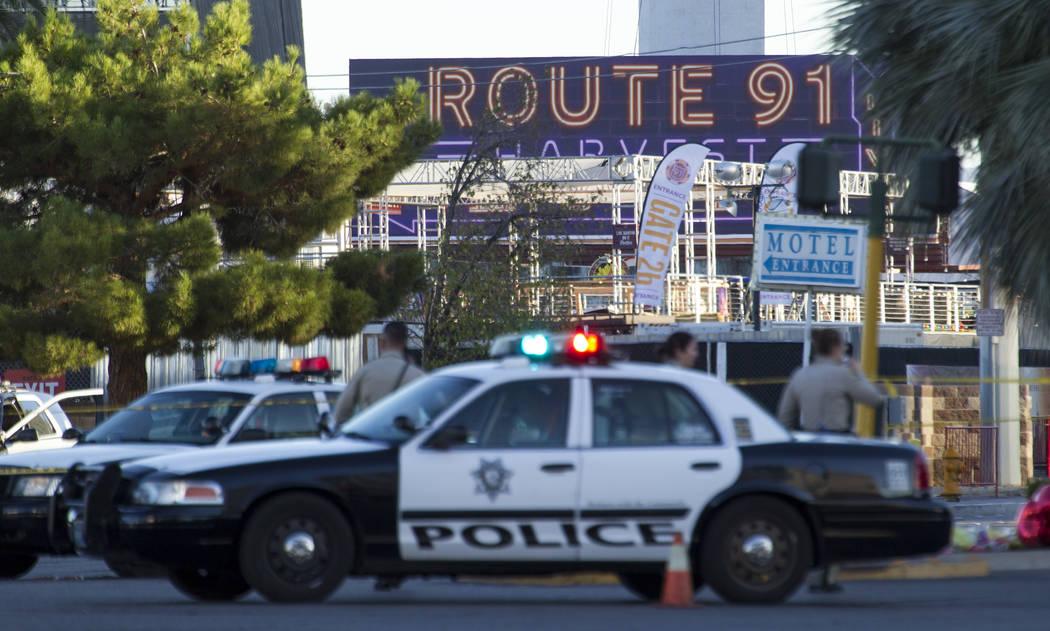 Las Vegas police block the roads at the scene along Las Vegas Boulevard and Reno Avenue on Mond ...