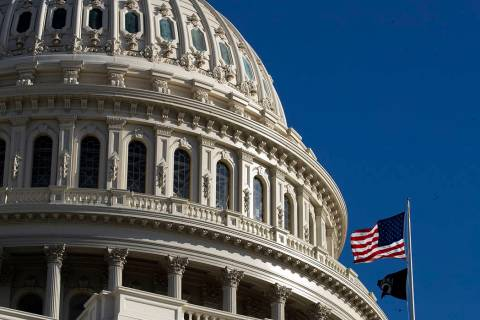 The U.S. flag flies over the U.S. Capitol in Washington, Sunday, Jan. 19, 2020. (AP Photo/Manue ...