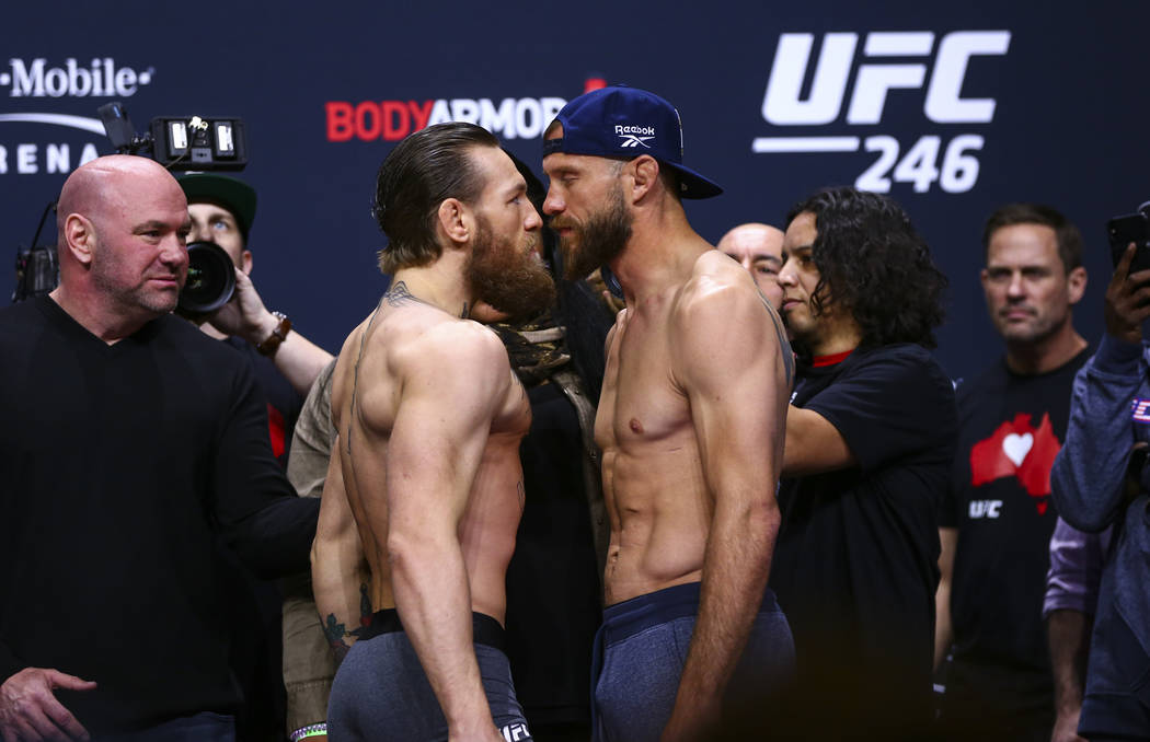 "Conor McGregor, left, faces off against Donald ""Cowboy"" Cerrone ahead of their welter ..."