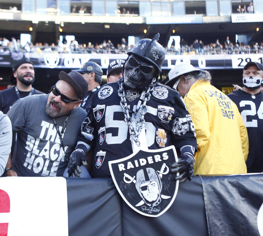 An Oakland Raiders in the Black Hole at Oakland-Alameda County Coliseum during the first half o ...