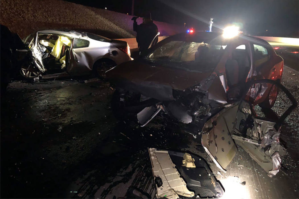 Police respond to the scene of a fatal crash in the southbound lanes of Interstate 215 near the ...