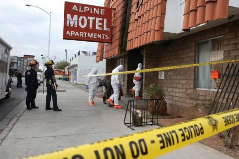 Las Vegas Fire Department investigators enter the Alpine Motel Apartments on Dec. 23, 2019, as ...
