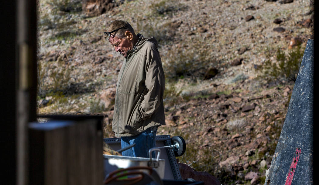 Richard Roman continues to clean out his cave after being evicted by Boulder City in the hills ...