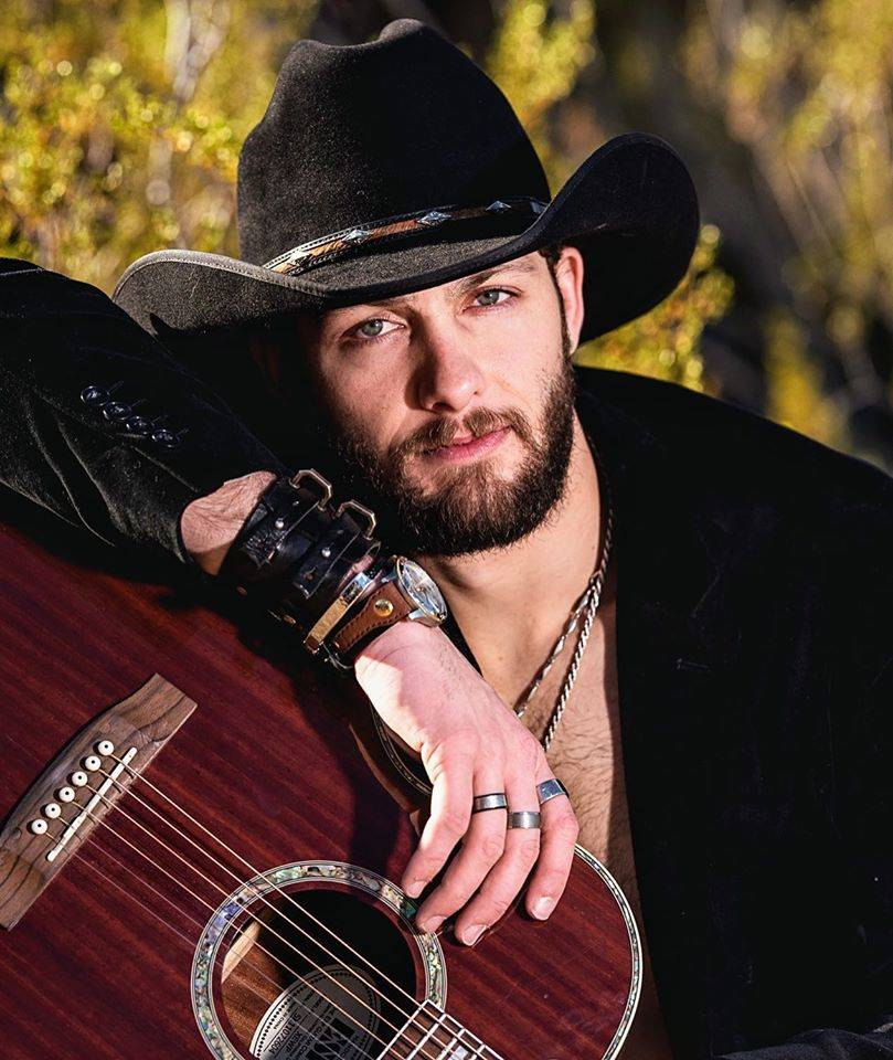 """Country singer Dez Hoston takes issue with Eminem's gun control advocacy in his """"Darkness"""" vide ..."""