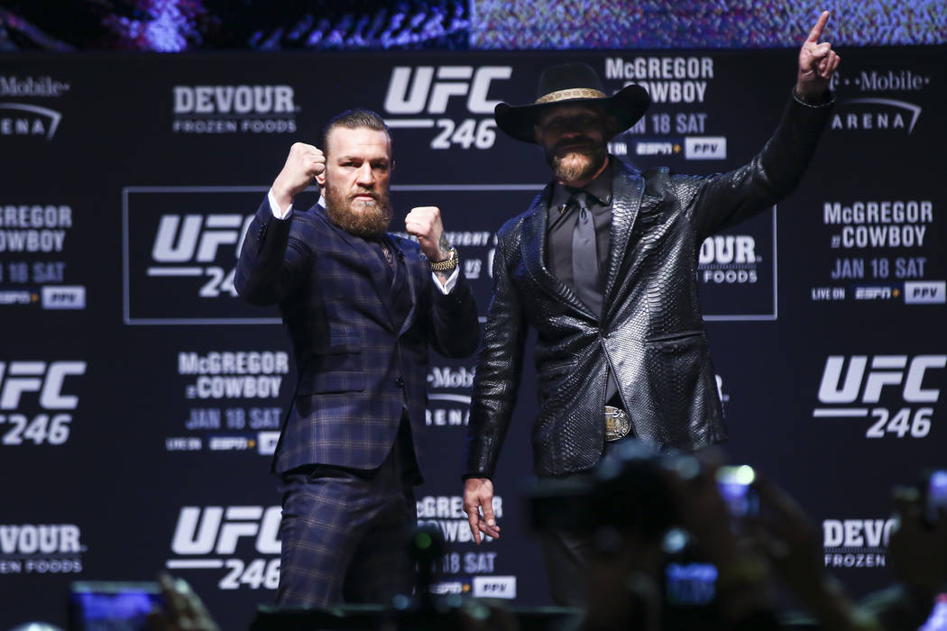 """Conor McGregor, left, and Donald """"Cowboy"""" Cerrone pose for pictures during a press conference a ..."""
