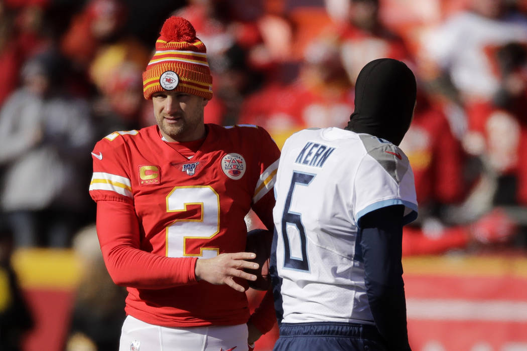 Kansas City Chiefs' Dustin Colquitt talks to Tennessee Titans' Brett Kern before the NFL AFC Ch ...