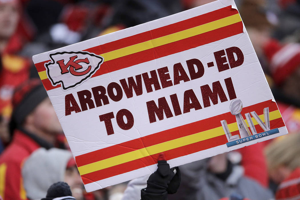 Fans hold signs during the second half of the NFL AFC Championship football game between the Ka ...