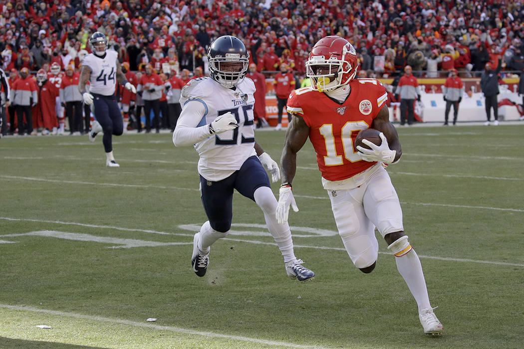 Kansas City Chiefs' Tyreek Hill runs for a touchdown during the first half of the NFL AFC Champ ...