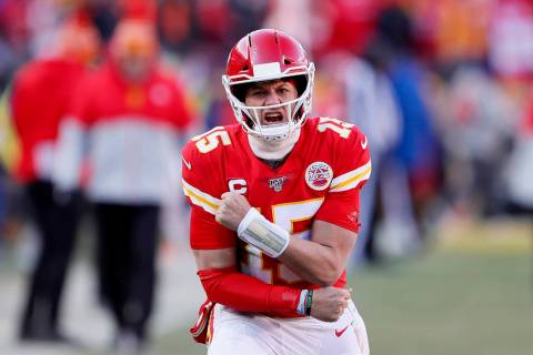 Kansas City Chiefs' Patrick Mahomes reacts after throwing a touchdown pass to Tyreek Hill durin ...