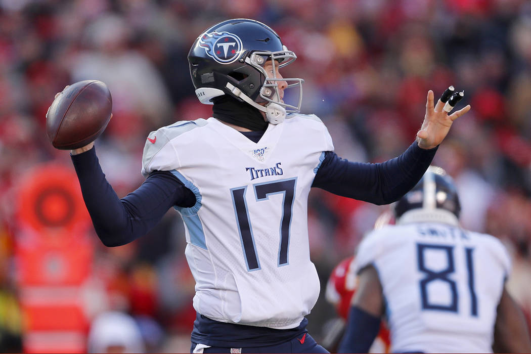 Tennessee Titans' Ryan Tannehill throws during the first half of the NFL AFC Championship footb ...