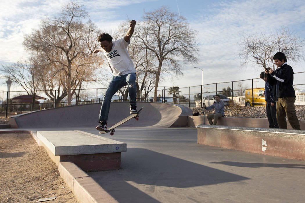 Devaughn Claire, of North Hollywood, Calif., practices tricks as his friend Orlando Garcia of L ...