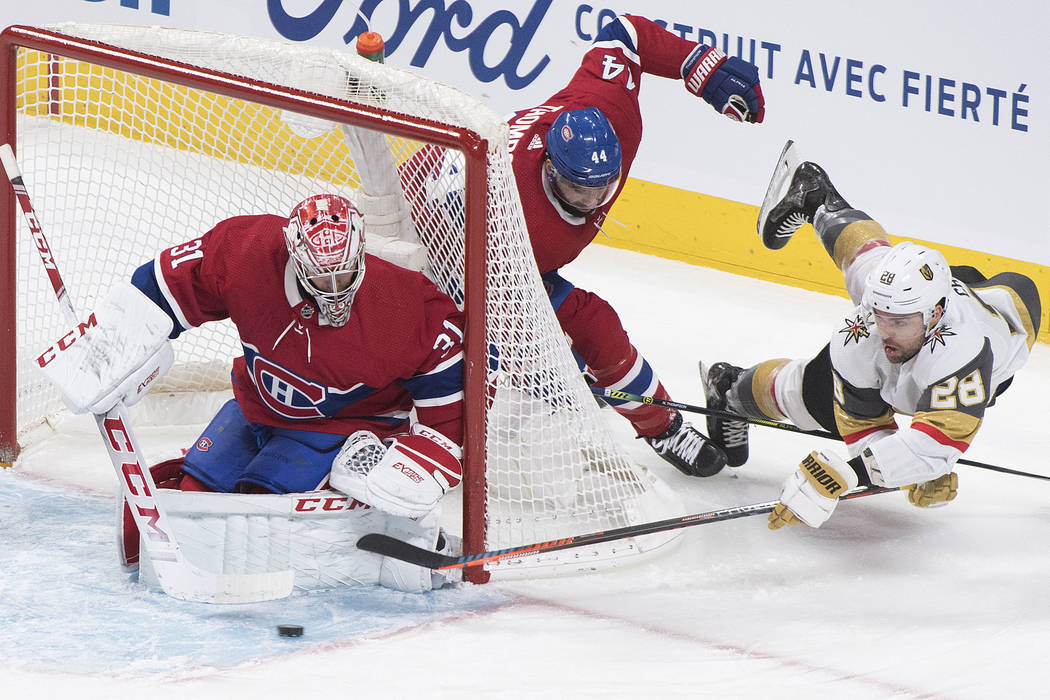 Vegas Golden Knights' William Carrier (28) lunges for the puck as he moves in against Montreal ...