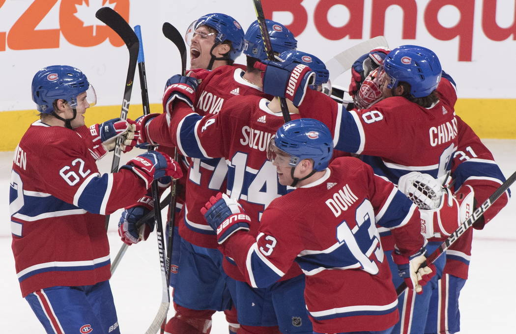 Montreal Canadiens celebrate after defeating the Vegas Golden Knights in an NHL hockey game in ...