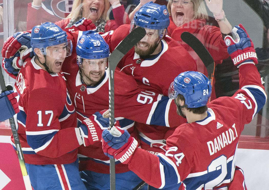Montreal Canadiens' Ilya Kovalchuk (17) celebrates with teammates Tomas Tatar (90), Shea Weber ...
