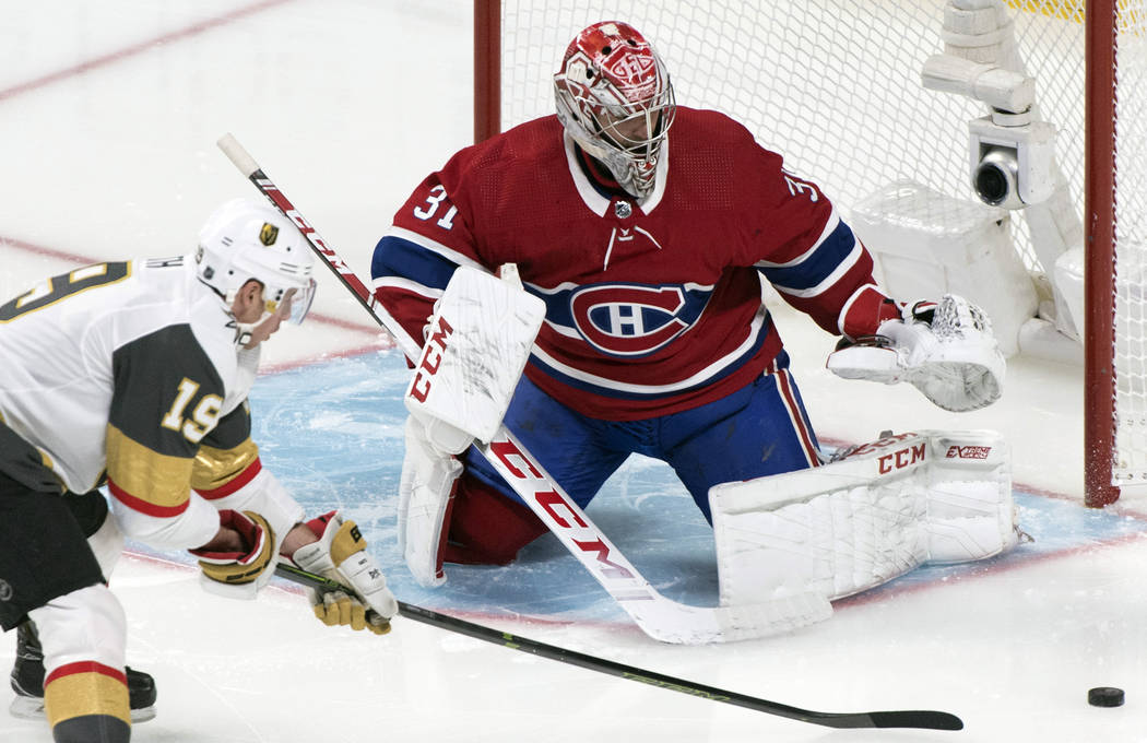 Vegas Golden Knights' Reilly Smith, left, moves in against Montreal Canadiens goaltender Carey ...
