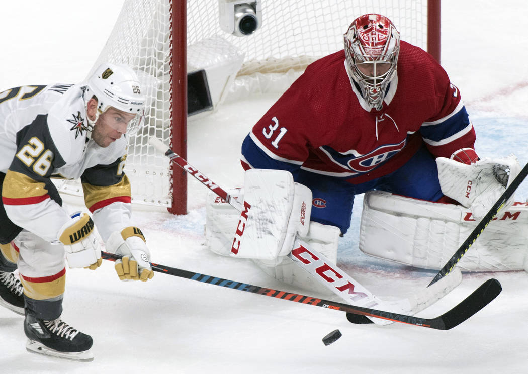 Vegas Golden Knights' Paul Stastny, left, moves in against Montreal Canadiens goaltender Carey ...