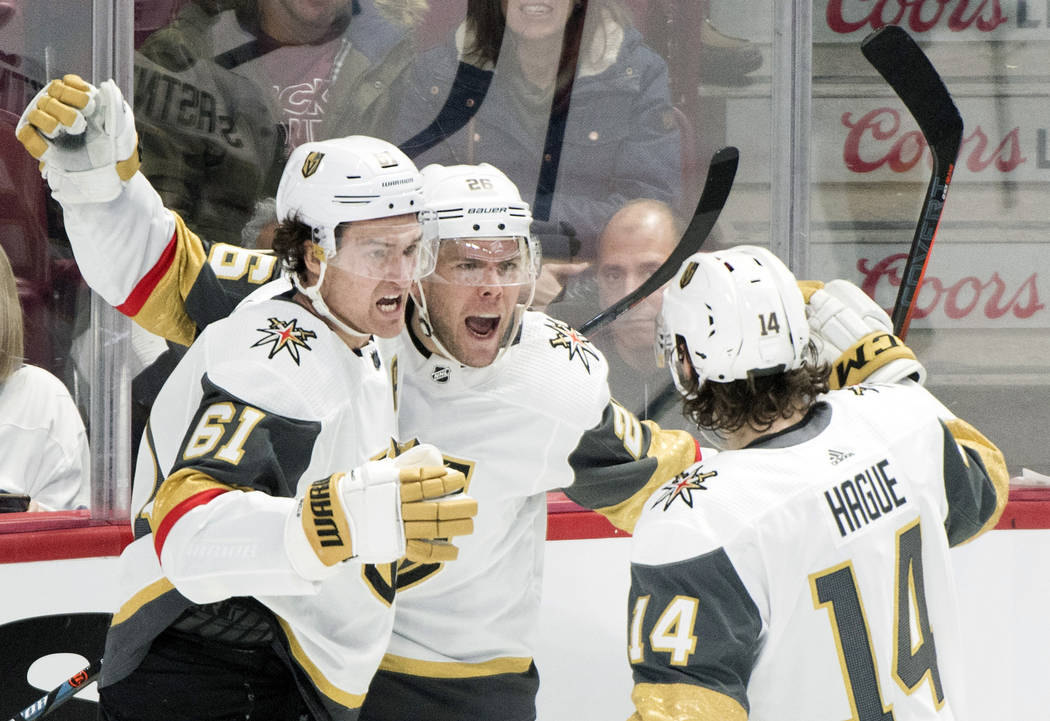 Vegas Golden Knights' Paul Stastny (26) celebrates with teammates Mark Stone (61) and Nicolas H ...