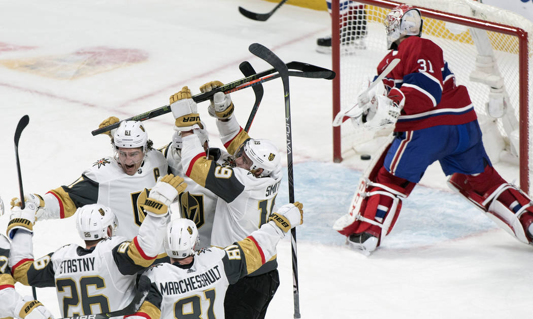 Montreal Canadiens goaltender Carey Price, right, breaks his stick after being scored against b ...
