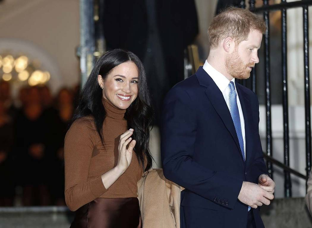 In this Jan. 7, 2020, file photo, Britain's Prince Harry and Meghan, Duchess of Sussex leave af ...