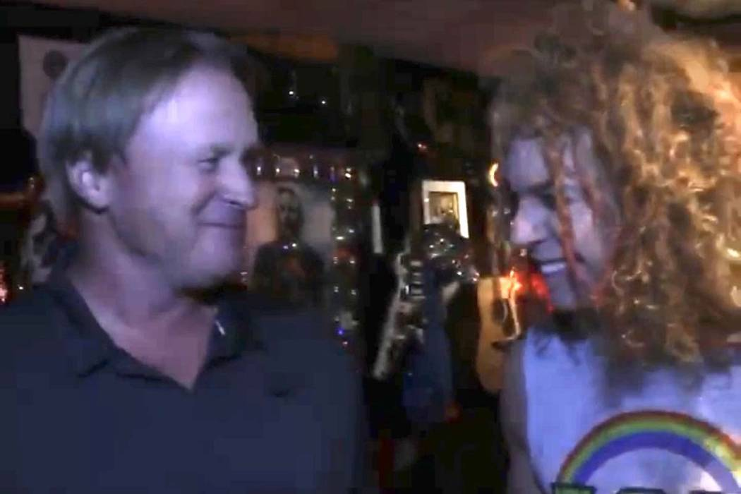 Raiders coach Jon Gruden, left, is shown with Luxor headliner Carrot Top at Atrium Showroom on ...