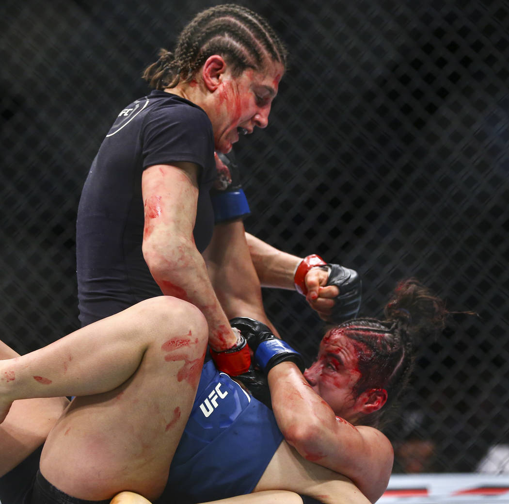 Roxanne Modafferi, left, fights Maycee Barber during their flyweight bout at UFC 246 at T-Mobil ...