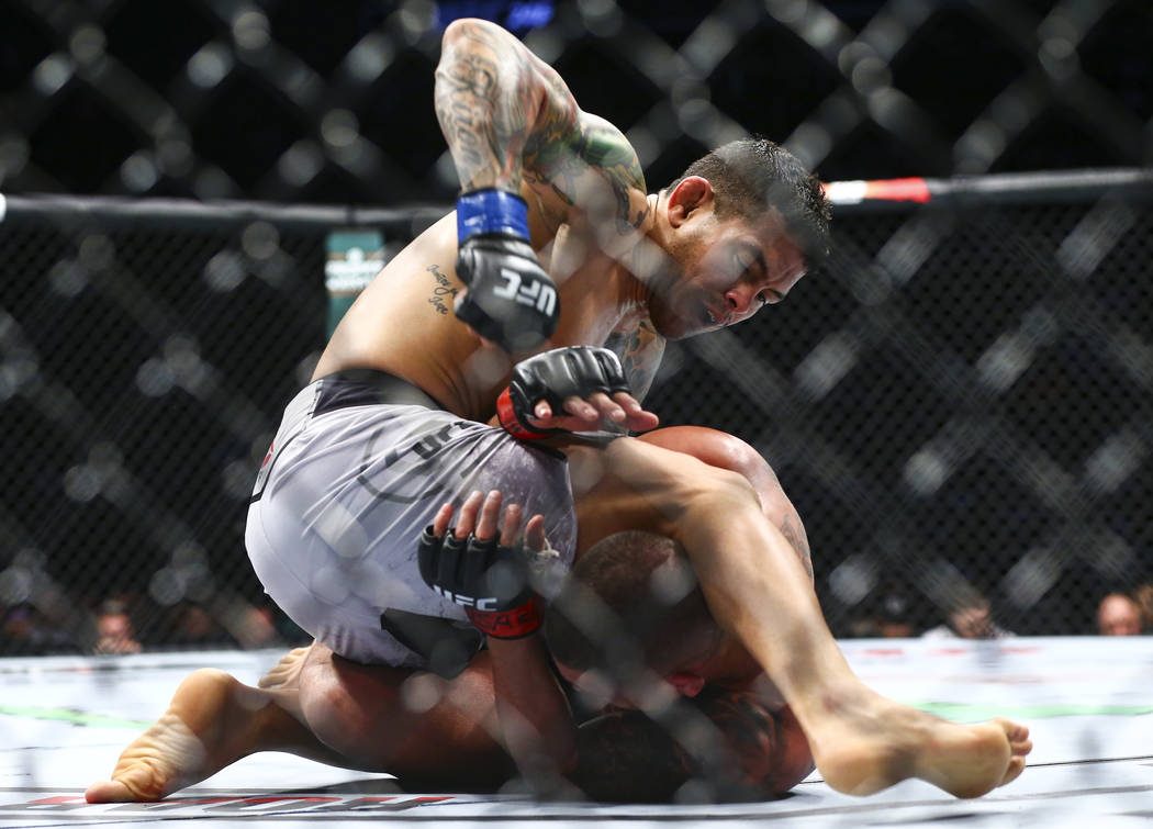 Diego Ferreira, above, fights Anthony Pettis during their lightweight bout at UFC 246 at T-Mobi ...