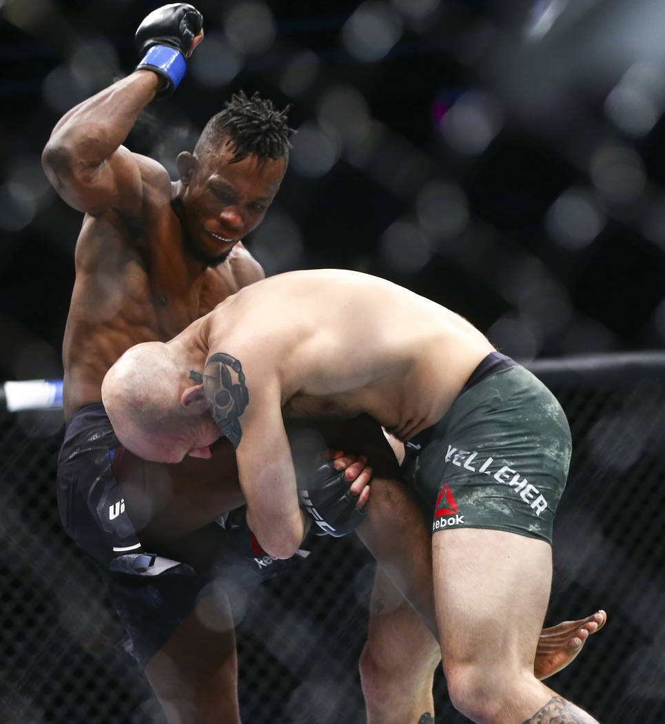 Brian Kelleher, right, takes Ode' Osbourne to the mat during their bantamweight bout at UFC 246 ...