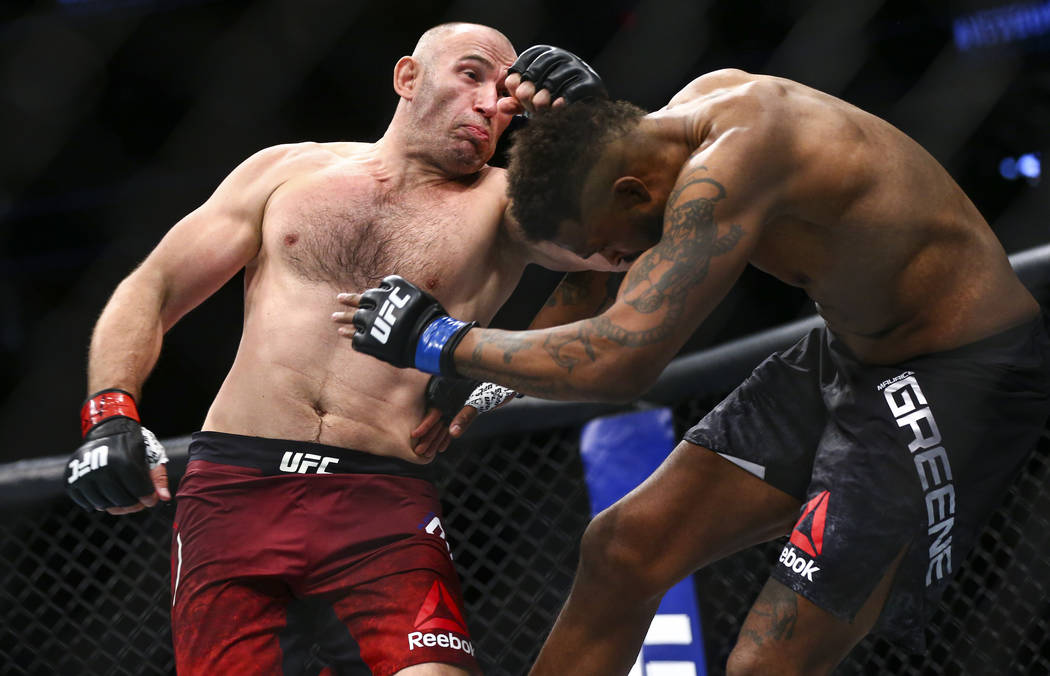 Aleksei Oleinik, left, fights Maurice Greene during their heavyweight bout at UFC 246 at T-Mobi ...