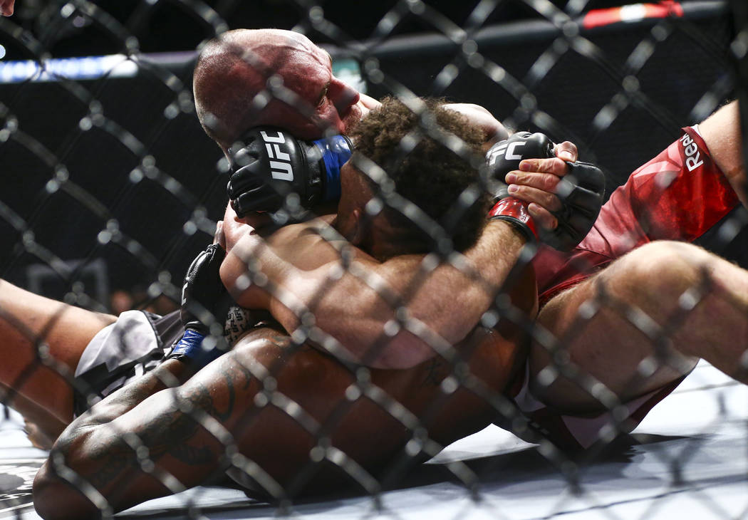 Aleksei Oleinik, above, fights Maurice Greene during their heavyweight bout at UFC 246 at T-Mob ...