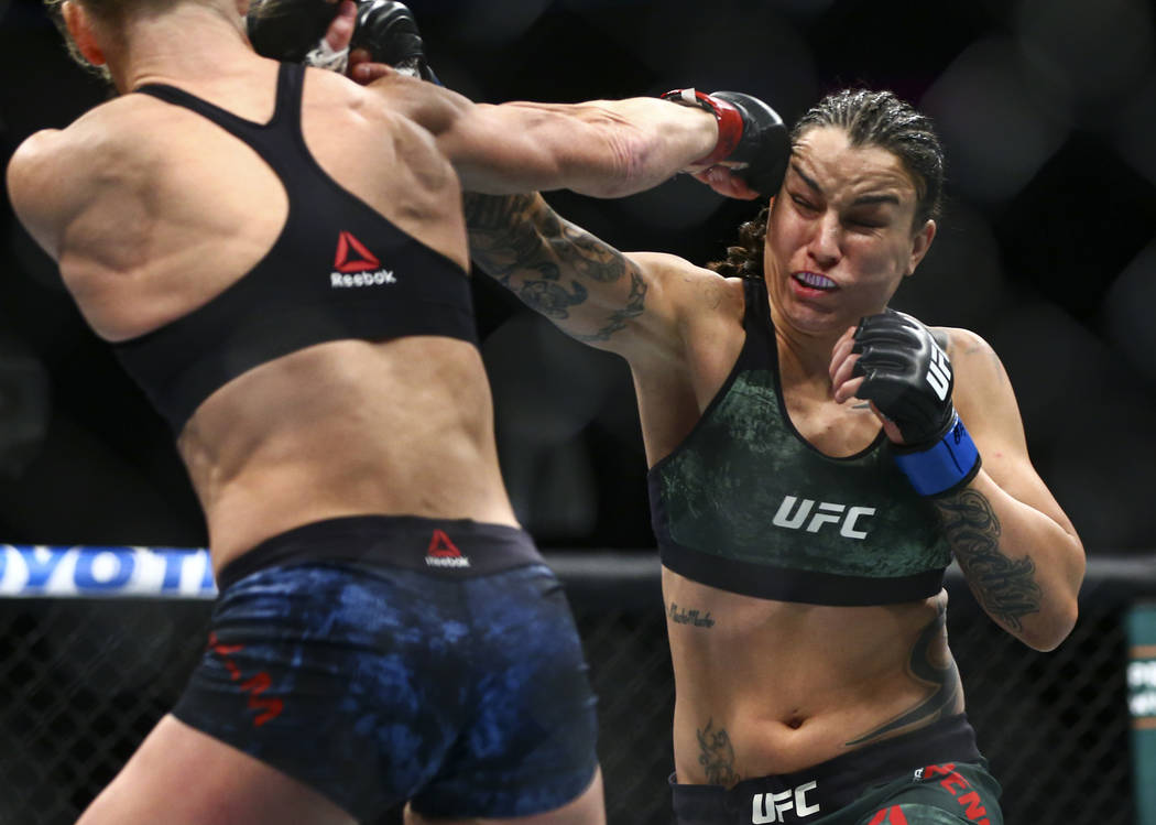 Holly Holm, left, fights Raquel Pennington during their bantamweight bout at UFC 246 at T-Mobil ...