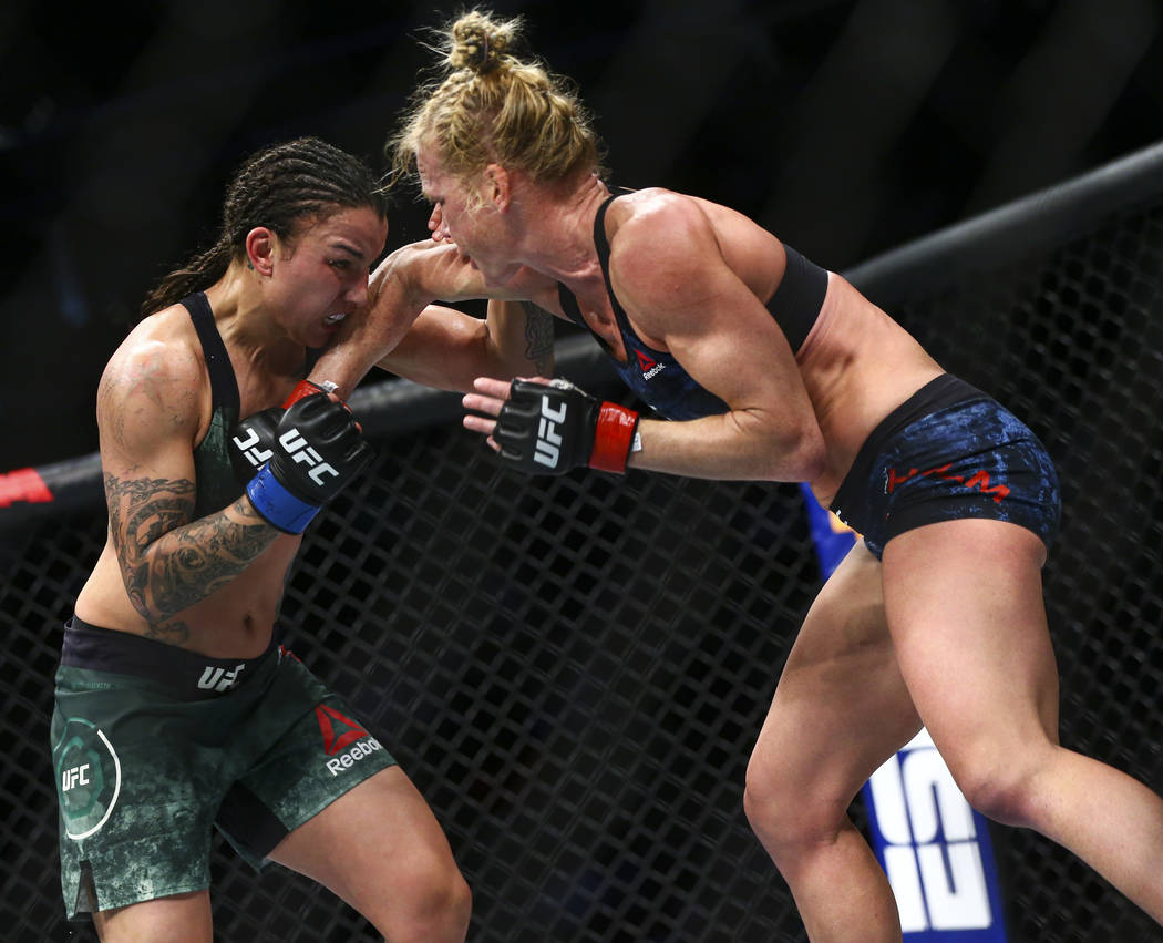 Raquel Pennington, left, fights Holly Holm during their bantamweight bout at UFC 246 at T-Mobil ...