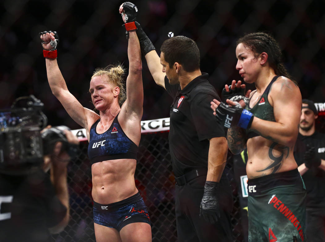 Holly Holm celebrates her unanimous decision victory over Raquel Pennington in their bantamweig ...