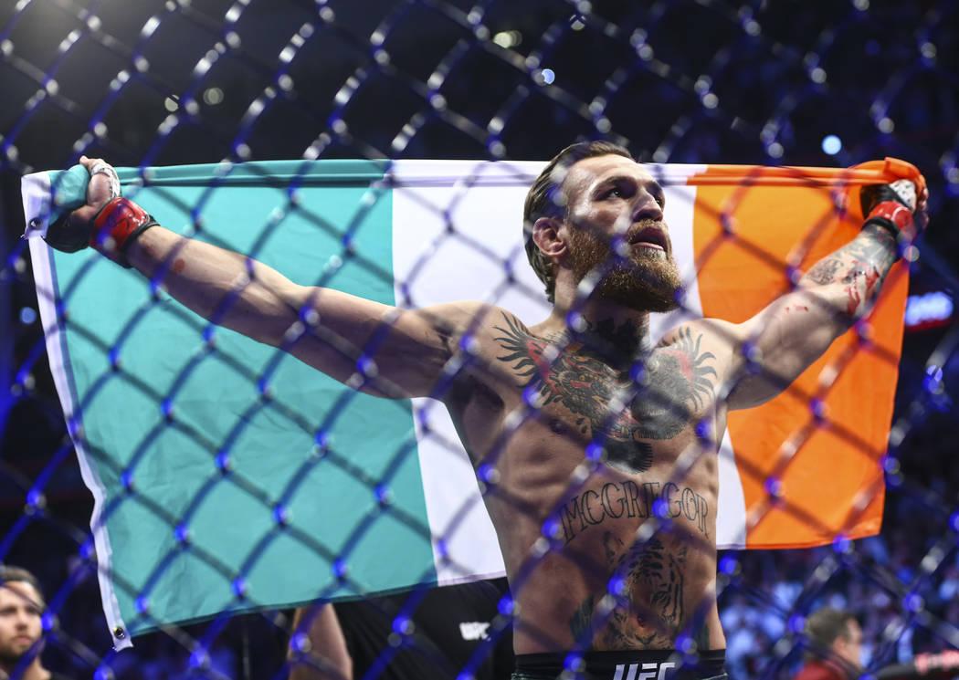 "Conor McGregor celebrates after defeating Donald ""Cowboy"" Cerrone via technical knock ..."