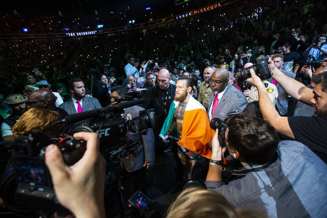 """Conor McGregor enters the arena for his fight against Donald """"Cowboy"""" Cerrone at UFC ..."""