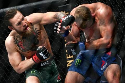 "Conor McGregor, left, fights Donald ""Cowboy"" Cerrone during their welterweight bout a ..."