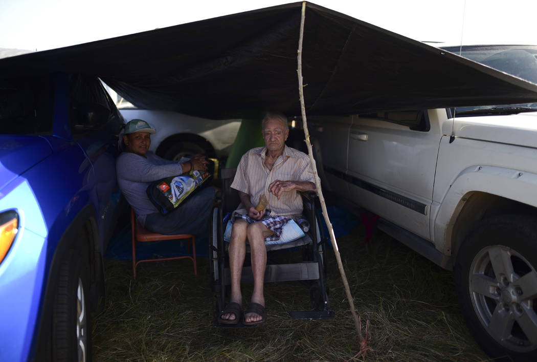 In this Friday, Jan. 10 photo, residents from the Indios neighborhood of Guayanilla, Puerto Ric ...
