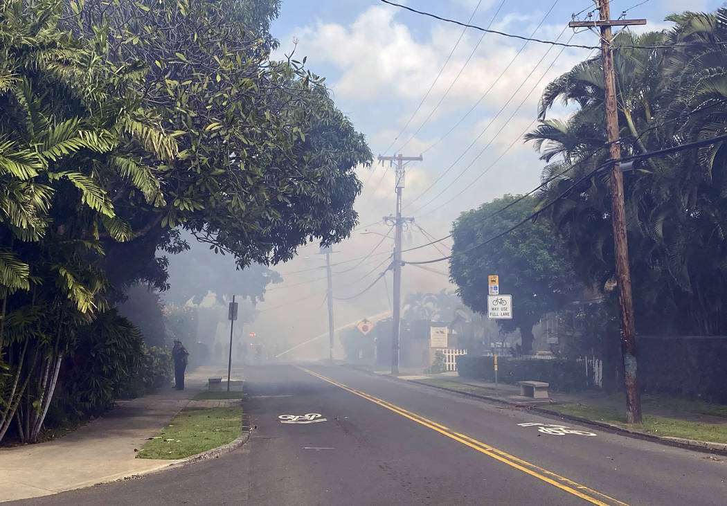 Smoke billows through the streets after a shooting in Honolulu, Sunday, Jan. 19, 2020. The Hono ...