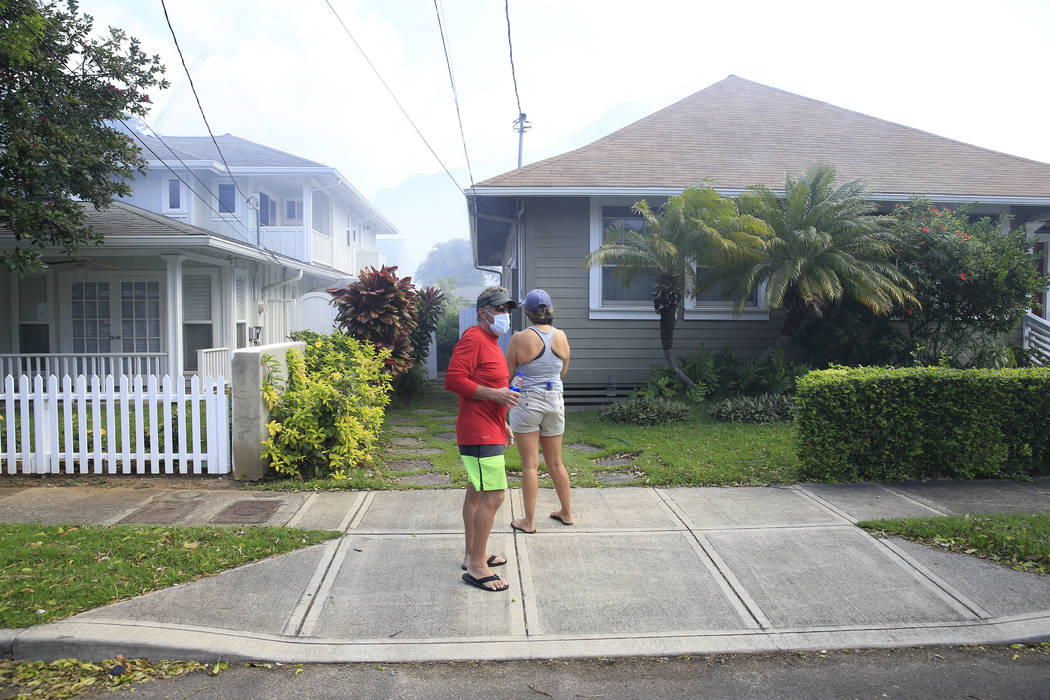 Residents of the Diamond Head neighborhood watch homes burn, Sunday, Jan. 19, 2020, in Honolulu ...