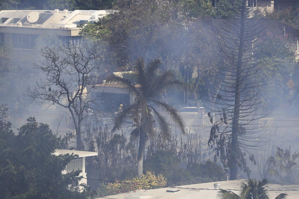 Several homes burn in near Diamond Head, Sunday, Jan. 19, 2020, in Honolulu, following a shooti ...