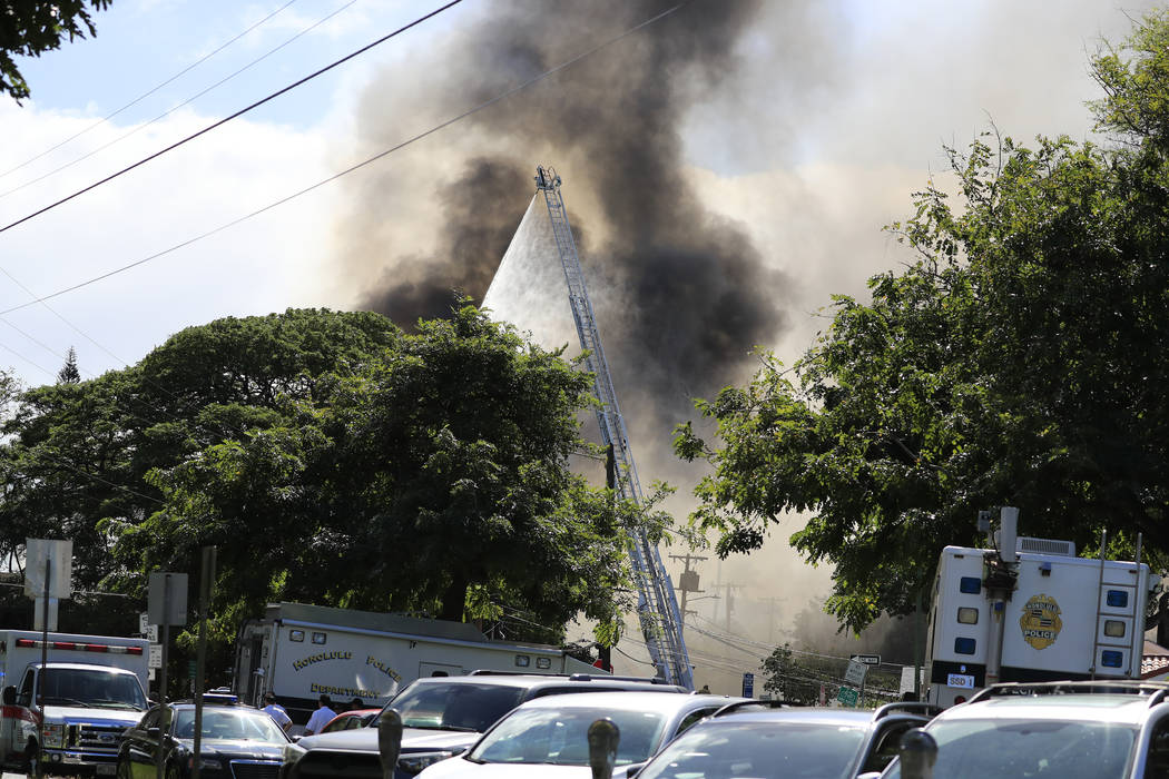Several house fires burn in a Diamond Head neighborhood Sunday, Jan. 19, 2020, in Honolulu, fol ...