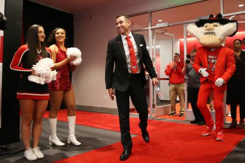New UNLV football head coach Marcus Arroyo is introduced during a press conference at UNLV's Fe ...
