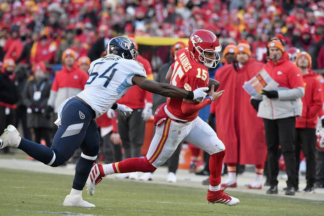 Kansas City Chiefs' Patrick Mahomes runs for a touchdown past Tennessee Titans linebacker Rasha ...