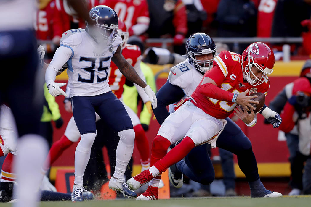 Kansas City Chiefs' Patrick Mahomes runs for a touchdown past Tennessee Titans defensive tackle ...