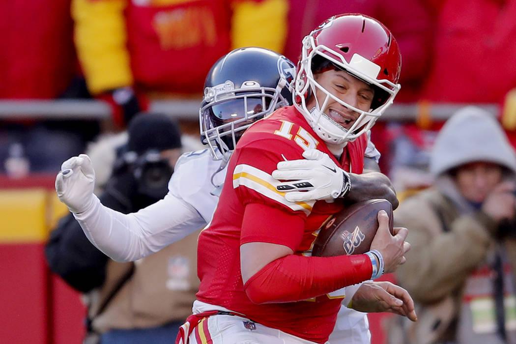 Kansas City Chiefs' Patrick Mahomes (15) runs for a touchdown against Tennessee Titans defensiv ...