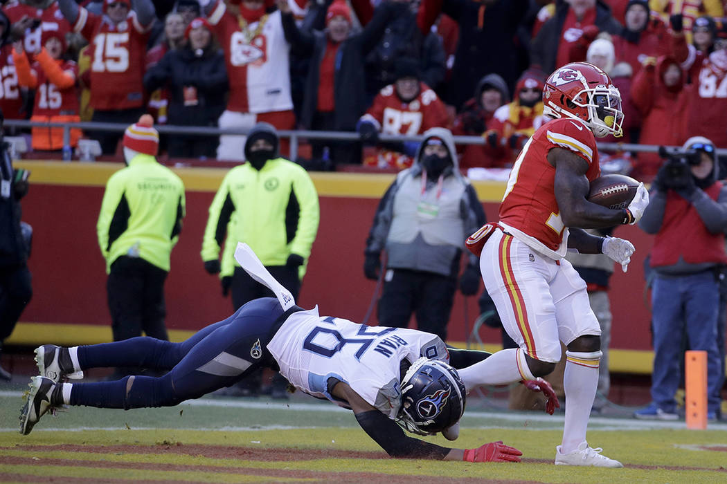 Kansas City Chiefs' Tyreek Hill catches a touchdown pass in front of Tennessee Titans' Logan Ry ...