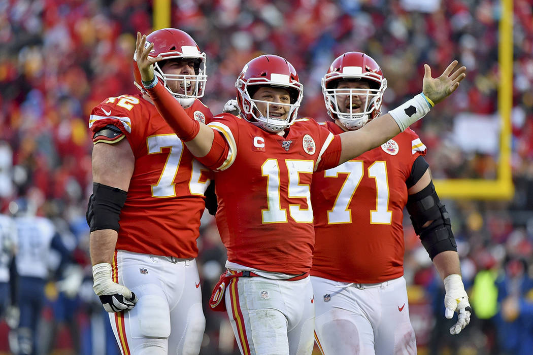 Kansas City Chiefs' Patrick Mahomes (15) celebrates a touchdown pass with Eric Fisher (72) and ...