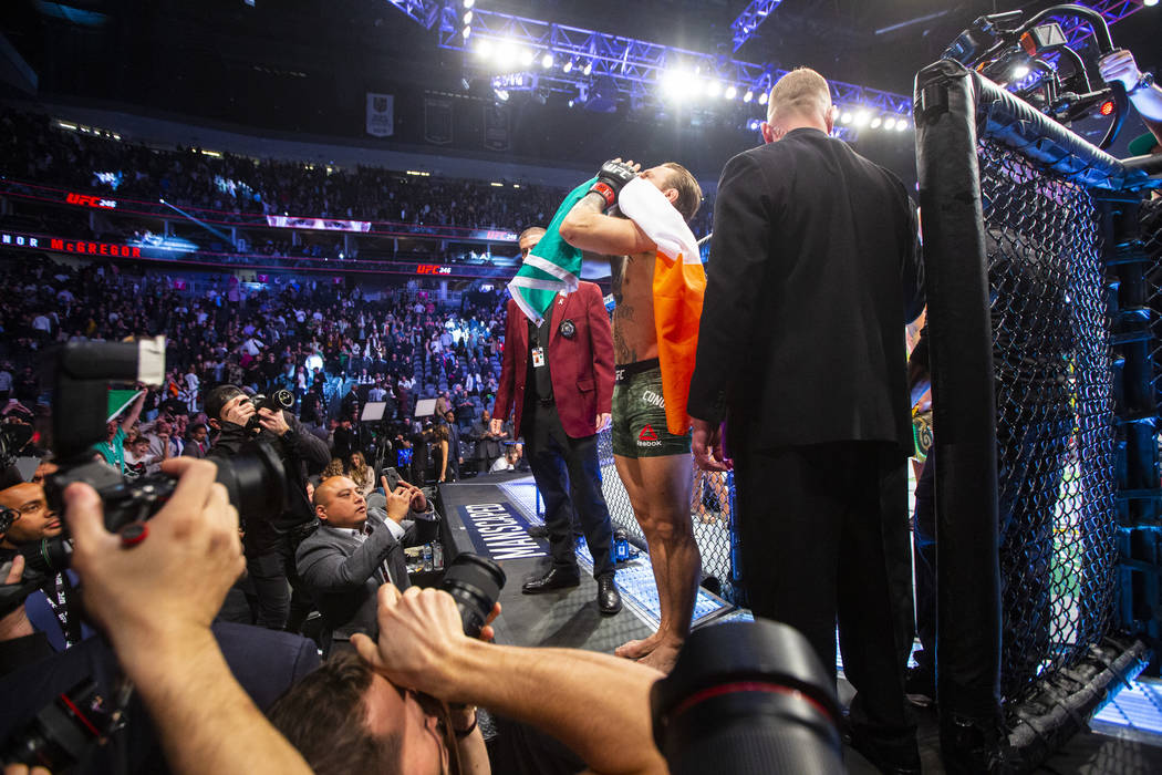 "Conor McGregor motions to the crowd after defeating Donald ""Cowboy"" Cerrone via techn ..."